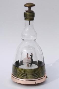 60s vintage decanter bottle, dancing couple music box plays waltz On the Street Where You Live