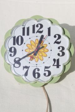 70s vintage GE electric wall clock, retro avocado green plastic daisy kitchen clock