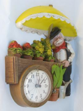 70s vintage Burwood plastic wall clock flower vendor push cart peddler