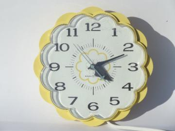 70s vintage GE electric kitchen wall clock, retro yellow daisy flower