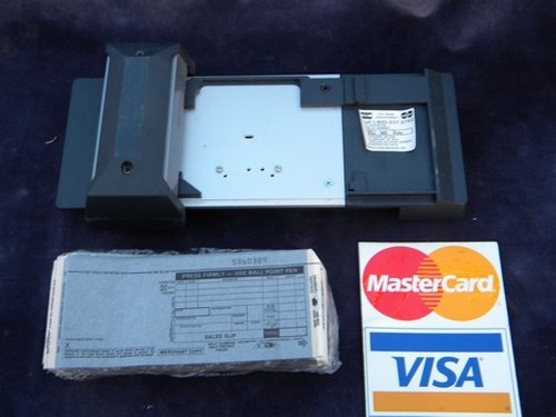how to use a manual credit card imprinter