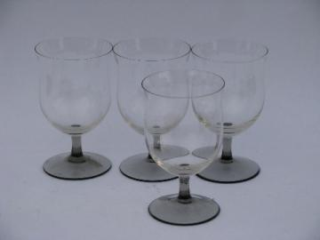 Four wine glasses, smoke grey & crystal glass stemware goblets