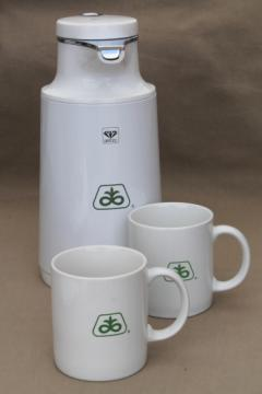Glass lined insulated pitcher & coffee mugs w/ vintage Pioneer seed advertising