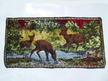 Kitschy vintage wall hanging tapestry, baby deer or elk in mountain stream