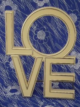 LOVE in big plastic letters, retro 70s hippie vintage desk sign ornament