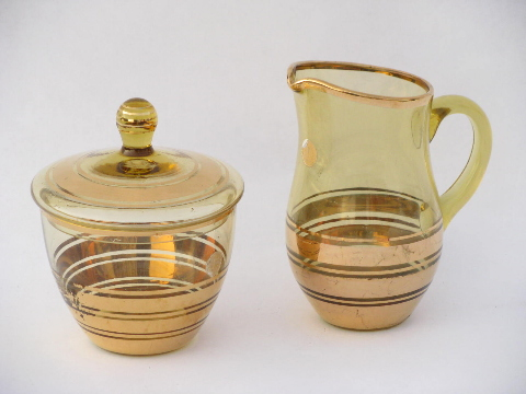 Old gold decorated amber glass cream pitcher & sugar, never used w/ original label