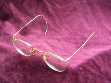 Old gold rimless spectacles or eyeglass frames, vintage Bausch & Lomb