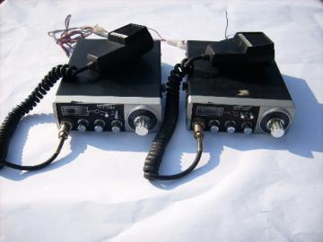 Pair of vintage Gemtronics GTX 3323 mobile CB transceiver radios with microphones and manual