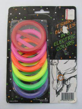 Retro 1980s neon electric colors plastic t-shirt buckles, flashdance style!