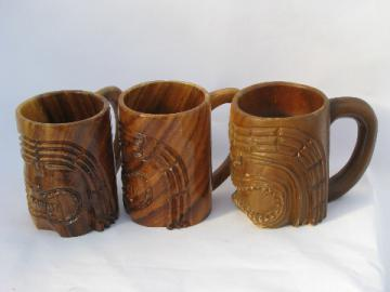 Retro carved wood tiki cups, Hawaiian or South Pacific wooden masks