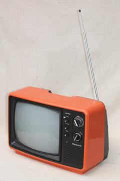 retro  mod orange TV set, 1970s portable television w/ rabbit ear antenna