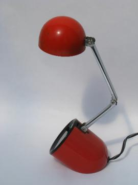 Retro mod red-orange bullet shape reading or desk light, folds to capsule