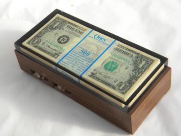 Retro US money novelty transistor radio, stack of dollar bills, 1970s vintage