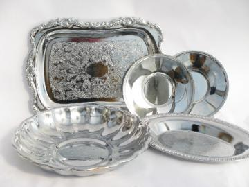Stack of shiny silver chrome plate trays, vintage 1950s-60s