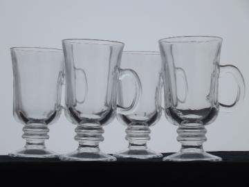 Tall cups for Irish coffee, set of four clear glass footed mugs