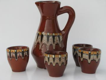 Troyan pottery pitcher and glasses, Bulgarian redware w/ colored glazes
