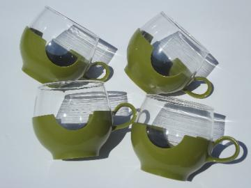 Vintage 70s Pyrex roly-poly glasses in lime green plastic cup holders