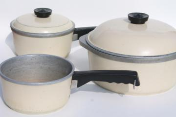vintage Club aluminum cookware, ivory color dutch oven pot and sauce pans