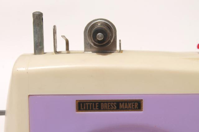 vintage Japan toy sewing machine in lavender purple plastic - needs restoration work