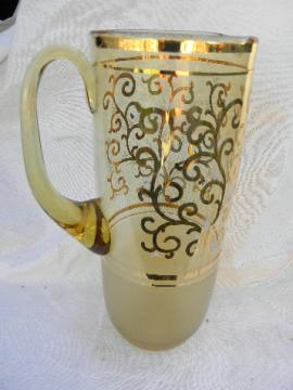 Vintage barware, tall thin drinks pitcher, pale amber glass w/ gold