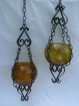 Vintage iron hanging planters w/ Italian blown glass globes in amber