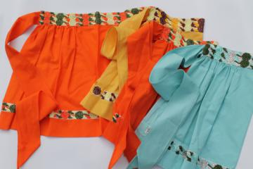 Vintage kitchen aprons w/ embroidered trim, retro aprons in orange, aqua, yellow