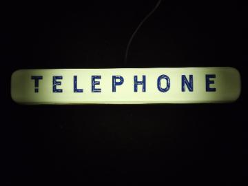 Vintage pay phone lighted sign, retro TELEPHONE booth pop art