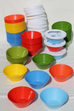 vintage plastic margarine tubs, bowls in bright primary colors for picnic dishes or fridge containers