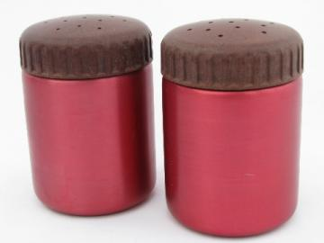 Vintage red anodized aluminum salt and peppers, Bakelite lids