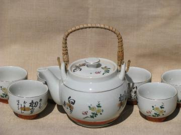 Wicker handle pottery teapot and bowl cups, vintage Japan painted tea set